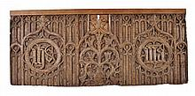 A carved oak relief panel in the Perpendicular