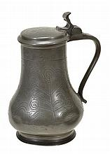 A wriggle worked pewter lidded flaggon, early 18th