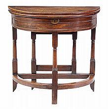 A walnut semi-elliptical folding tea table, circa
