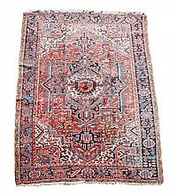 A Heriz carpet, decorated throughout with foliate