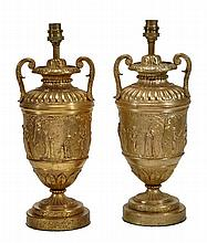 A pair of gilt metal twin handles urns fitted as