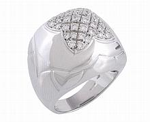 A Pyramid ring by Bulgari, the domed top pave set with brilliant cut diamonds