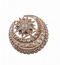An early 20th century diamond set Middle Eastern star and crescent brooch