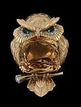 A gem set owl brooch by Cartier, circa 1960, with a mixed cut citrine set body