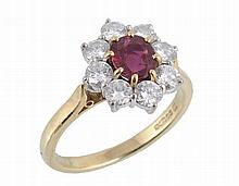 An 18 carat gold ruby and diamond ring by Garrard & Co