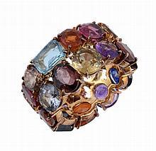A multi gem set ring, the band set throughout with vari cut gemstones