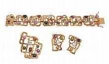 A multi gem set bracelet, composed of openwork textured links set with vari...