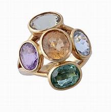 A multi gem set dress ring, the central oval shaped citrine collet set...
