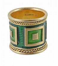 An 18 carat gold green enamel ring by Elizabeth Gage