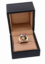 A gem set dress ring by Bulgari, the two colour setting set with a...