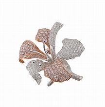 A diamond set orchid brooch, the pave set brilliant cut diamond petals and...