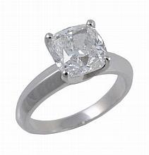 A diamond single stone ring, the cushion shaped modified brilliant cut...