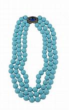 A reconstituted turquoise necklace, the three stranded necklace composed of...
