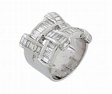 A diamond ring, composed of interlinking sections set throughout with...