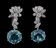 A pair of blue zircon and diamond earpendents