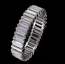 A diamond eternity ring, the baguette cut diamonds claw set, approximately 3