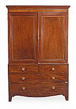 A Regency mahogany linen press, circa 1815, with a