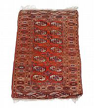 A Bokhara rug, the madder field decorated with two