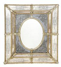 An etched and moulded glass wall mirror, in 18th