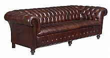 A brown leather upholstered Chesterfield sofa in