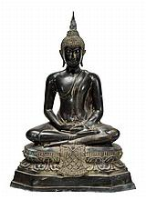A Thai bronze sitting Buddha sitting in a