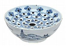 An English delft blue and white colander, probably