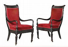 A pair of Ceylonese ebony framed and upholstered