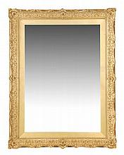 A giltwood and composition wall mirror, 20th