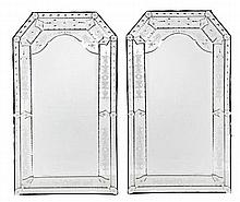 A pair of etched glass wall mirrors in Venetian