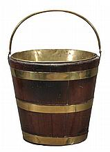 A George III mahogany and brass bound bucket,