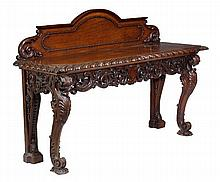 A carved oak serving table, in the manner of