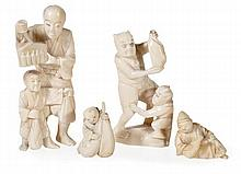 Four Japanese ivory carvings of figures, the