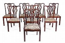 A set of eight mahogany dining chairs in George