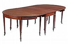 A George III mahogany extending dining table,