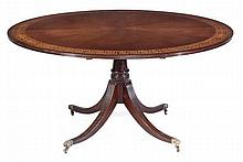 A mahogany circular topped table in Regency style,