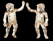 A pair of carved wood and cream painted figures of