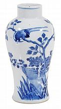 A small blue and white vase decorated with