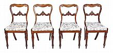 A set of four William IV rosewood dining chairs,