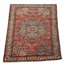 A Qum rug, the central circular ivory and
