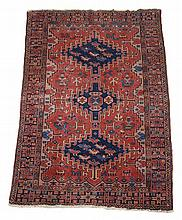 A Caucasian rug, the madder field with three