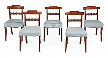A set of five George IV mahogany dining chairs,
