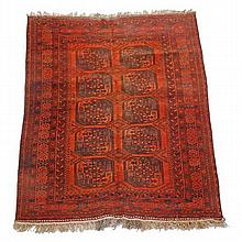 An Afghan carpet, the madder field decorated with