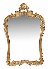 A carved giltwood wall mirror in Continental 18th