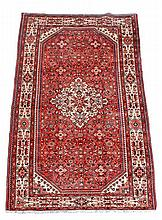 A Mahal carpet, the madder field decorated with a