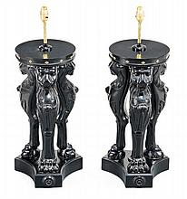 A pair of carved and ebonised wood table lamps in