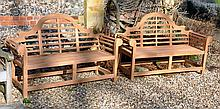 A pair of teak garden seats in the manner of Lutyens