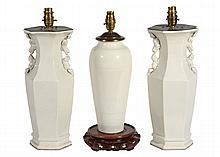 A pair of Chinese cream glazed ceramic vases fitted as table lamps