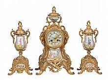 A gilt-metal and porcelain clock garniture de cheminée L