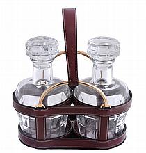 Hermes, a burgundy leather and gilt metal two bottle decanter carrier