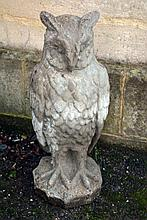 A reconstituted stone garden model of an owl, 20th century, portrayed standing